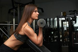 Young woman, lifting weights